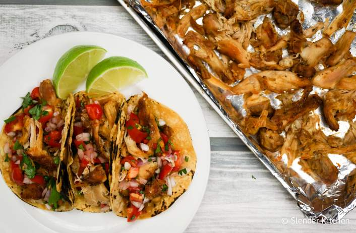 Slow Cooker Chicken Carnitas with corn tortillas and lime juice.