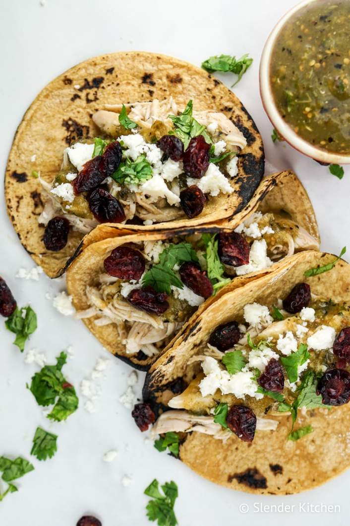 Slow Cooker Turkey Tacos with cranberries on corn tortillas