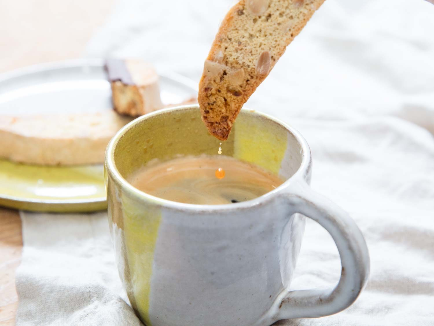 hot cup of coffee with biscotti