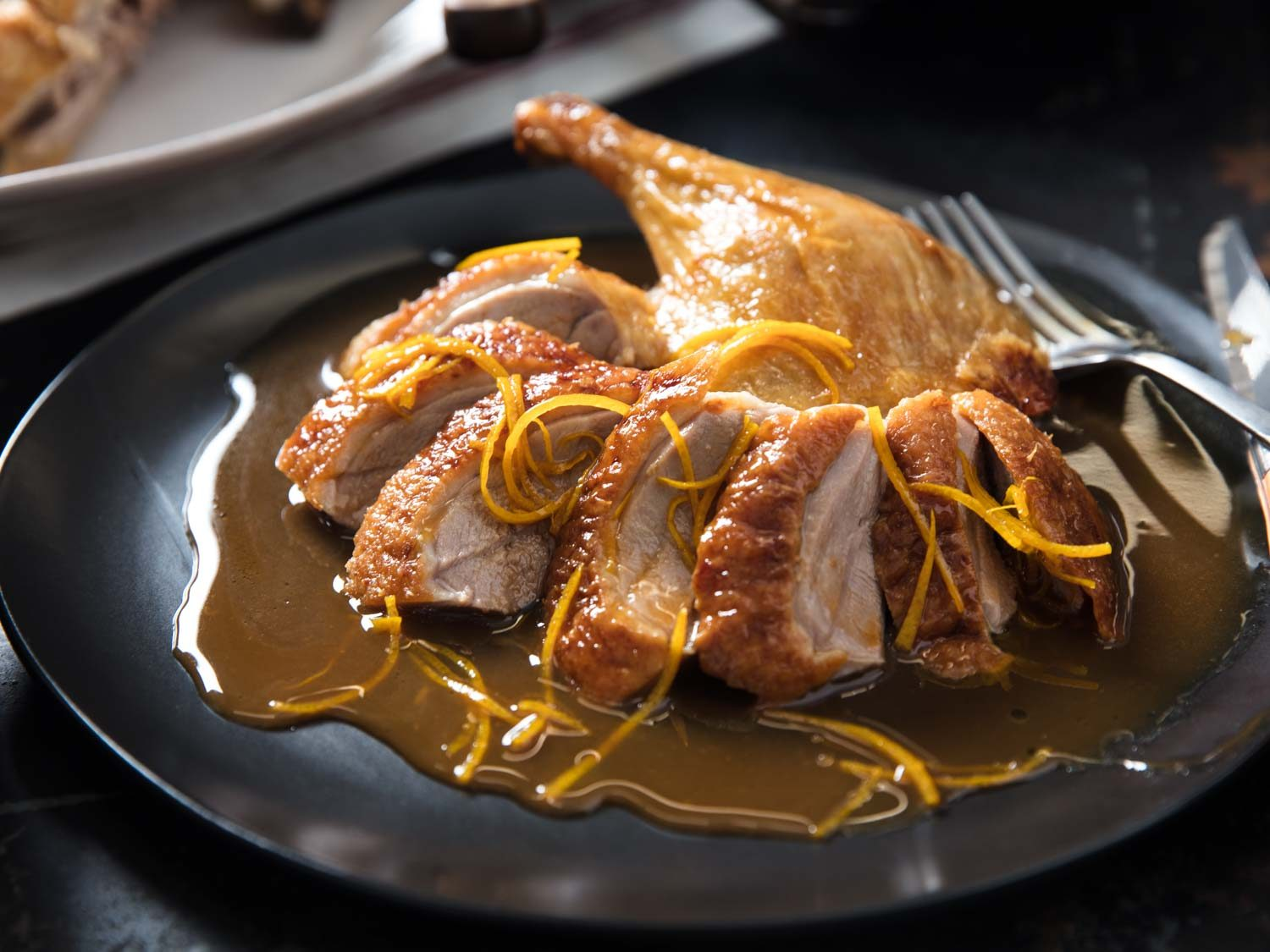 A plate of Duck à l'Orange with sauce